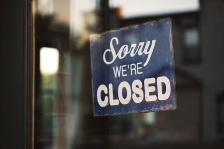 "Blue and white ""Sorry, We're Closed"" sign"