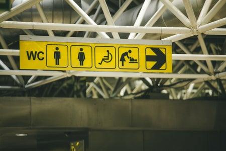 yellow sign with handicap symbol