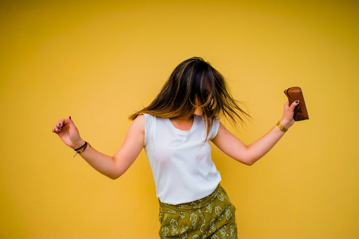 Yellow background woman dancing.