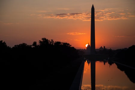 silhouette of the Washington Monument at sunset