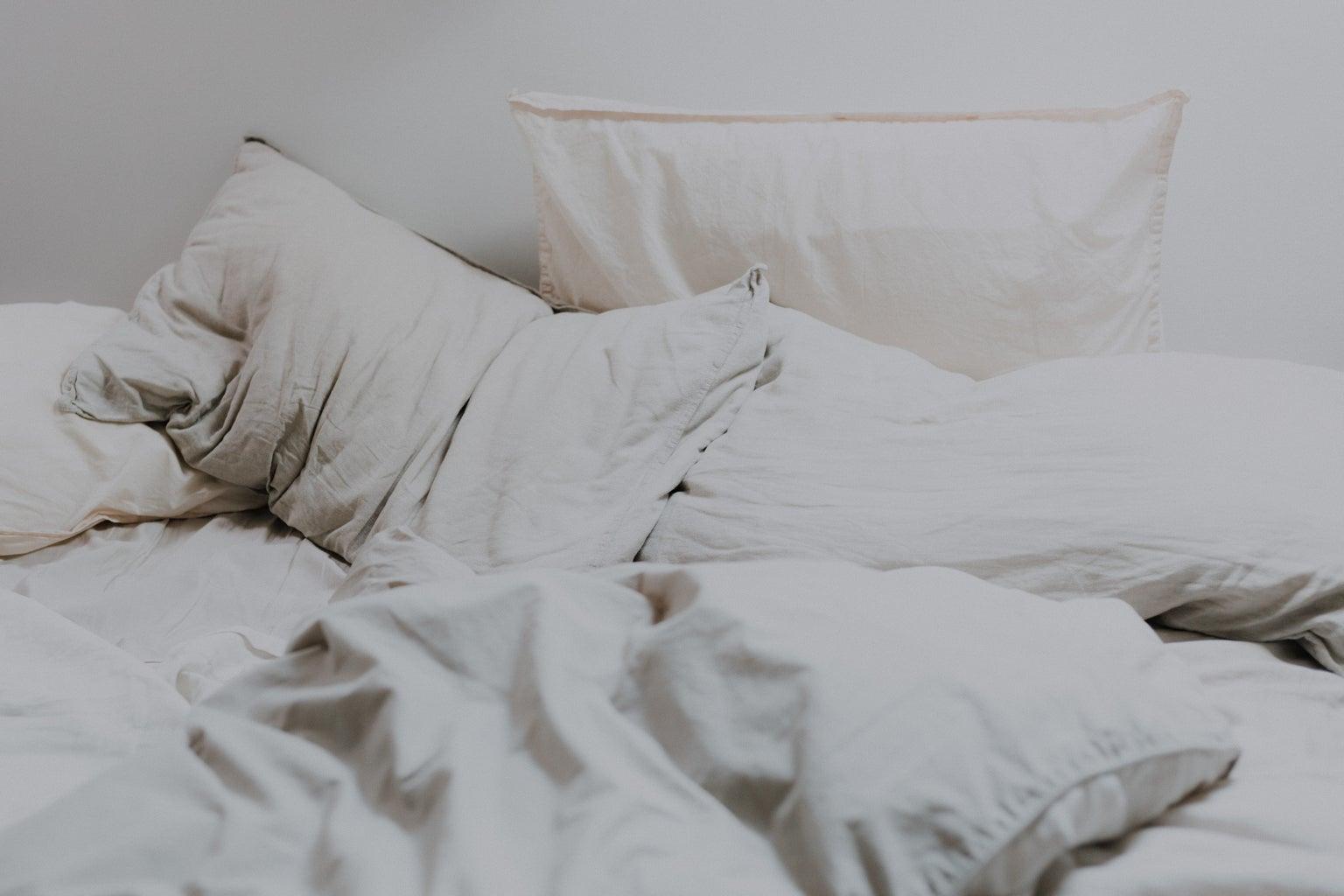 white pillows and white bedding