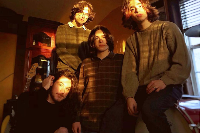 4 guys posing for a band photo