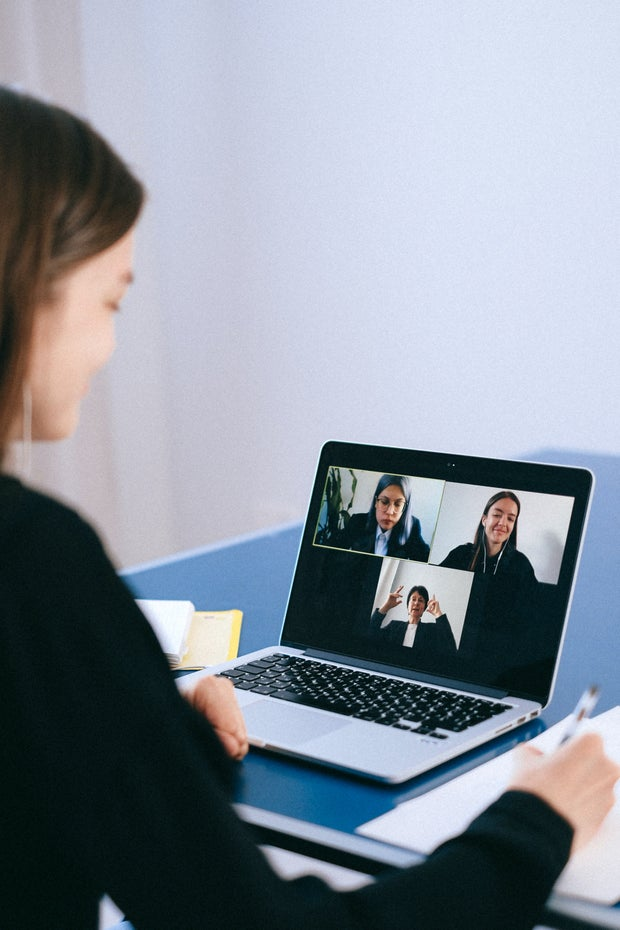 woman on a conference call with 3 others
