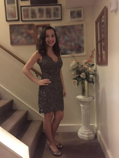 Picture of myself in my semi-formal dress w/ personal photos blurred out in background