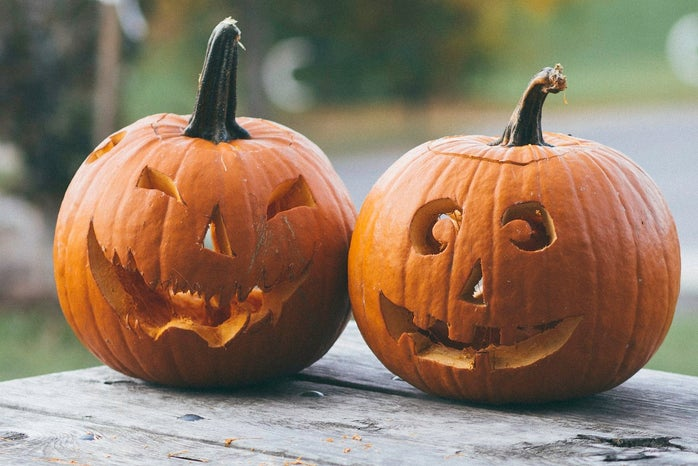 two carved pumpkins on table