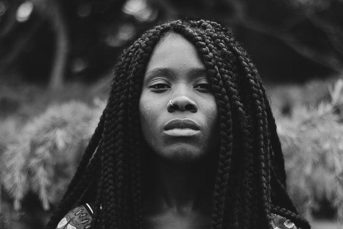 greyscale photo of braided hair woman