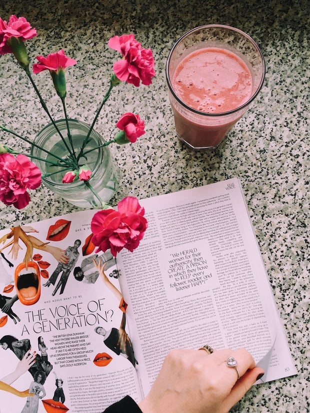 Open magazine with flowers and smoothie.