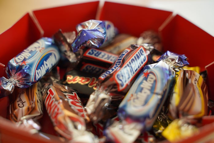 A close up shot of a bowl of Halloween candy.