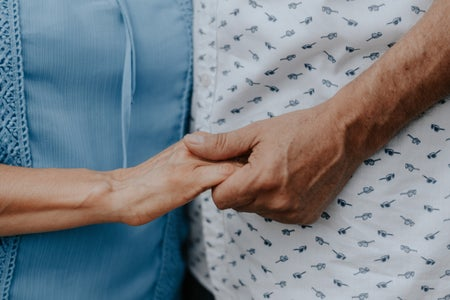 Elderly hands clasped togetther