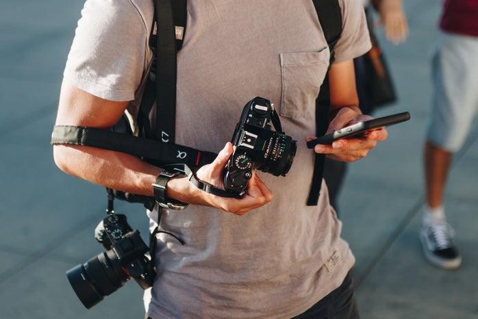man with cameras