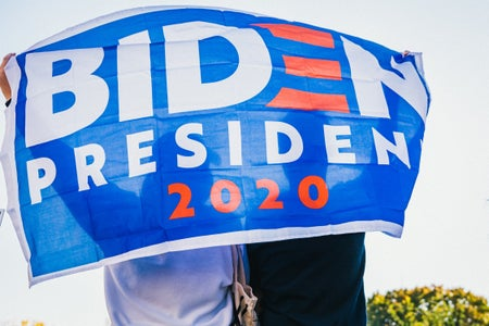 Person holding Biden 2020 flag