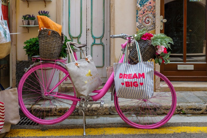 pink bicycle in front of a stoop