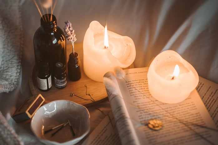 candles lit on books