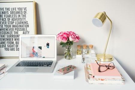 MacBook Air beside gold-colored desk lamp