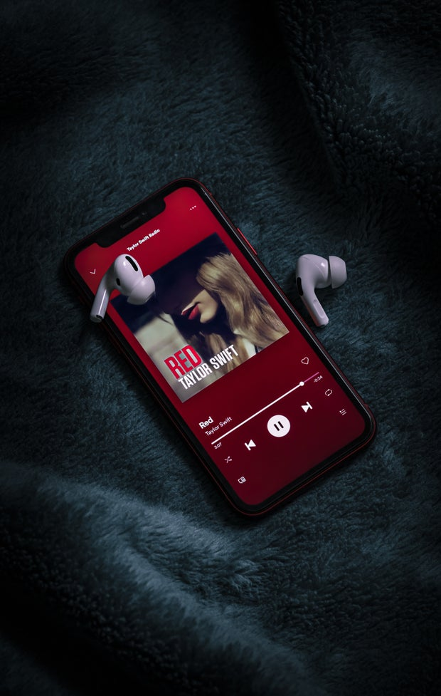 "Photo of a phone playing ""Red"" by Taylor Swift"