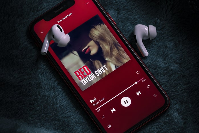 """Photo of a phone playing """"Red"""" by Taylor Swift"""