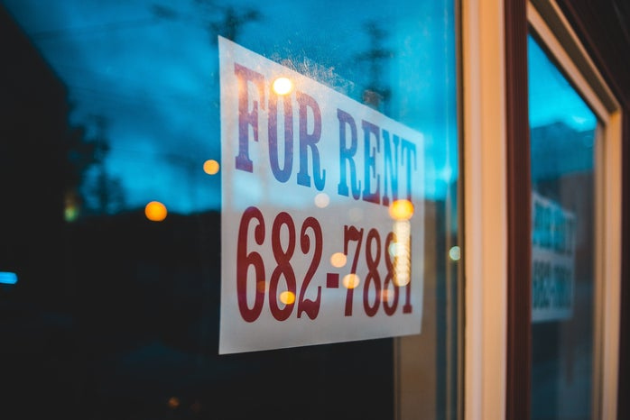 window with for rent sign