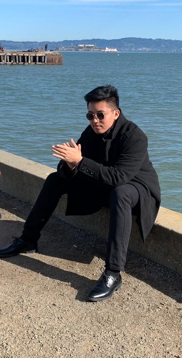 young man wearing black jacket