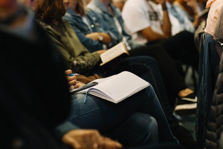 taking notes during meeting