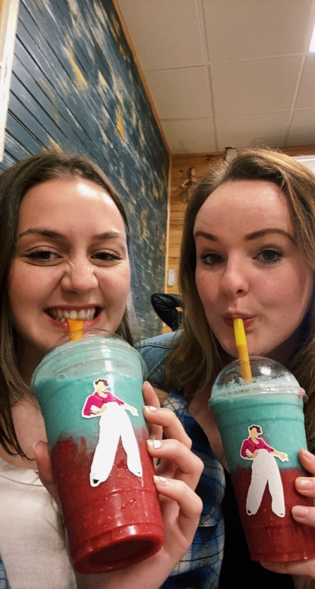 Abby and friend with their drinks at the Harry Styles cafe