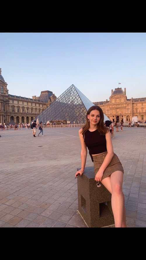 woman sitting outside the Louvre