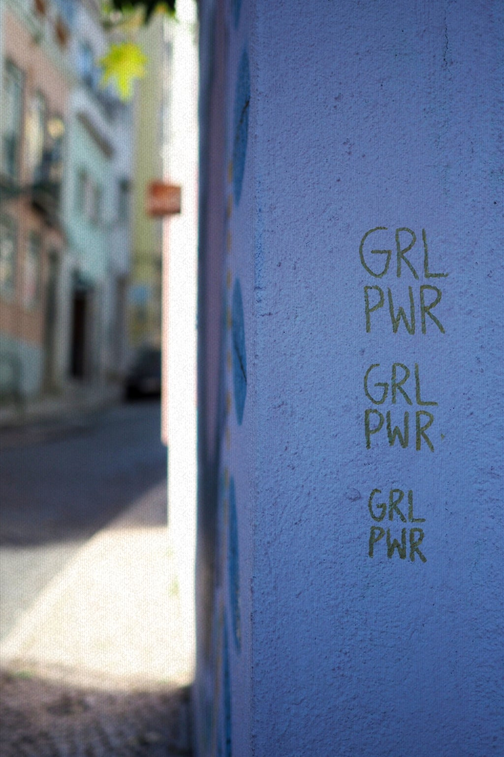 "\""GRL PWR\"" is written on the side of a building in Lisbon, Portugal."