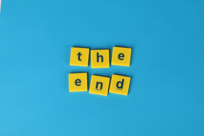 Letters on yellow tiles forming the end text
