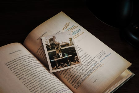 old photo on top of opened book
