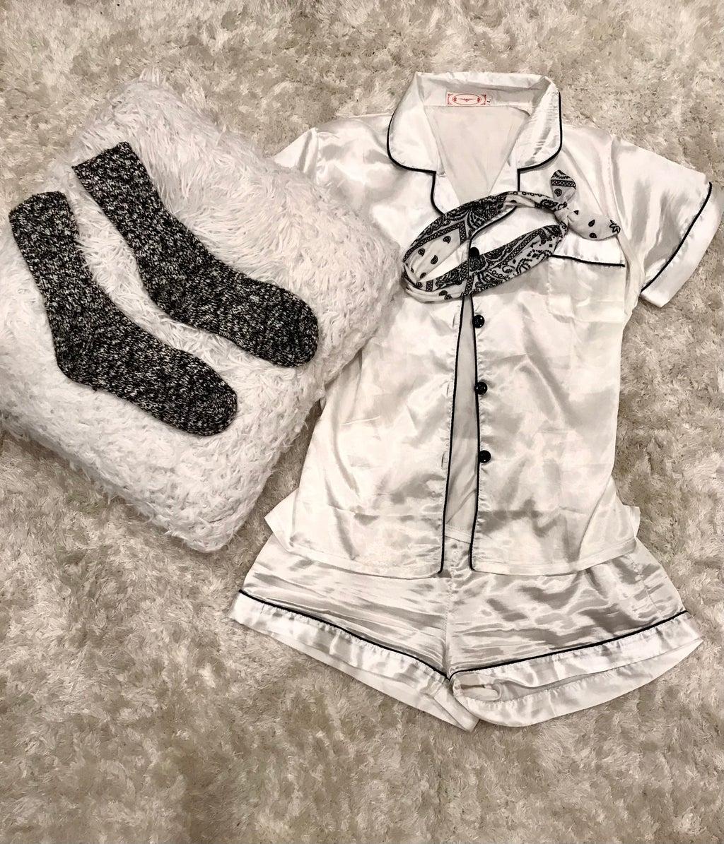 Black and white satin pajama set from SHEIN. Black and white socks and headband. White carpet.