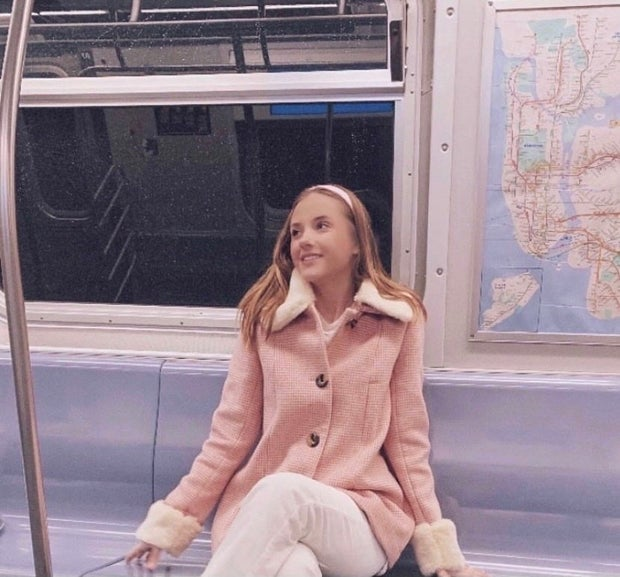young woman wearing pink jacket