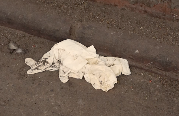 Outside New Delhi's GB Pant Hospital lie abandoned gloves, disposed of without adherence to bio-medical waste disposal norms