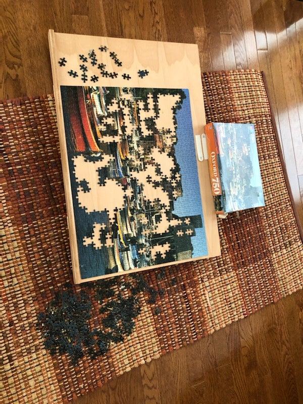 Unfinished Puzzle of Rug and Hardwood
