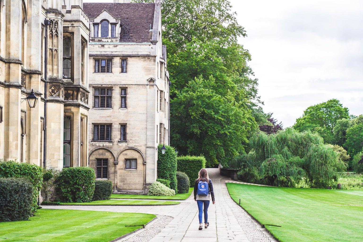 woman walking at the university of cambridge