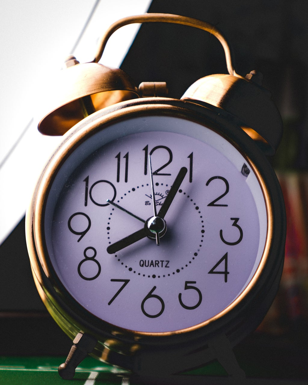 silver twin bell alarm clock at 8:05