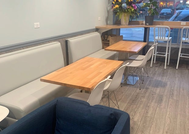 Grey benches, flowers on windowsill, wooden tables (Dang!)