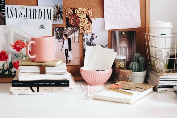 pink mug on stacked books