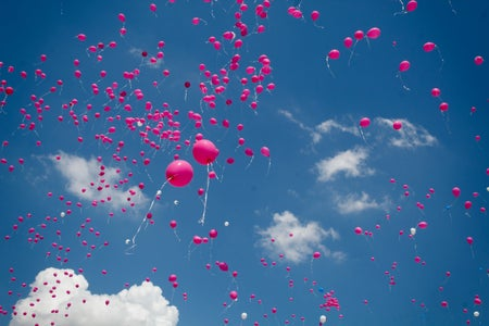 Pink balloons floating off into the air