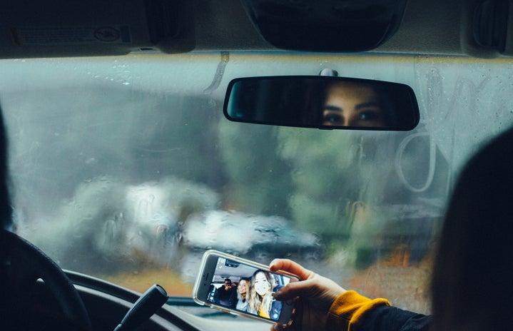 person taking selfie in car