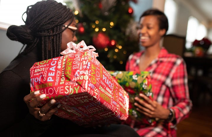 Black family opening presents on Christmas
