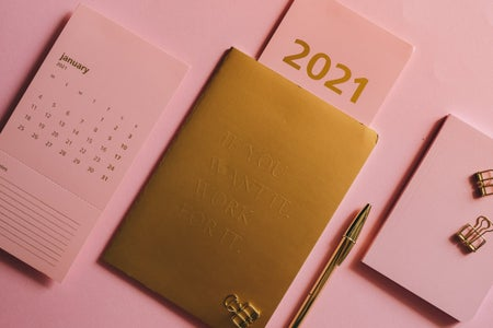 pink background with gold 2021 planner