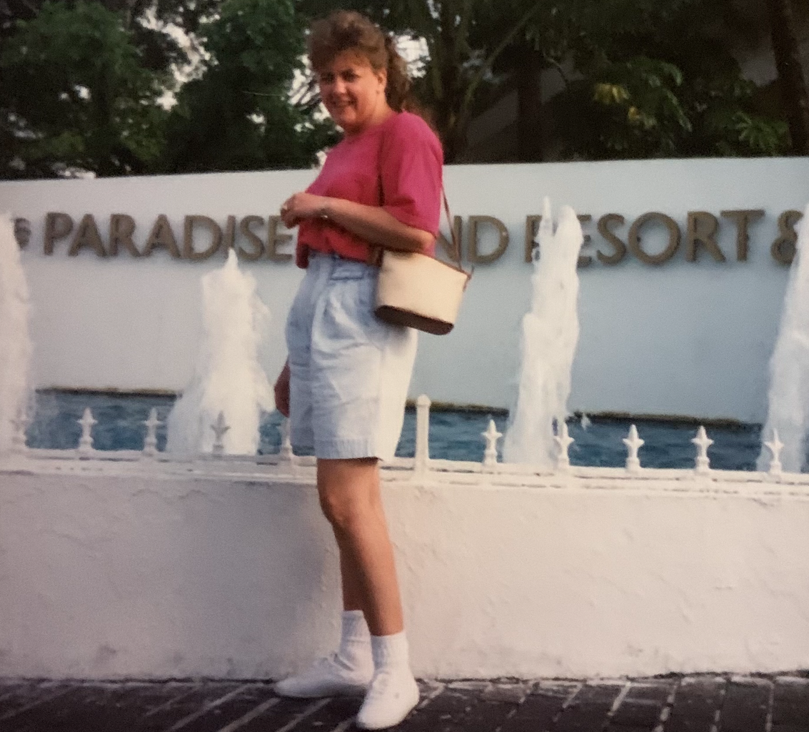 Woman poses outside of a resort