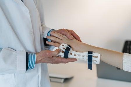 doctor with wrist brace