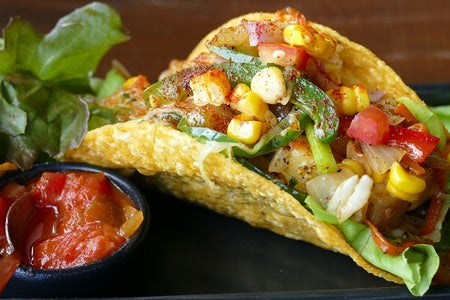 Taco with corn and salsa