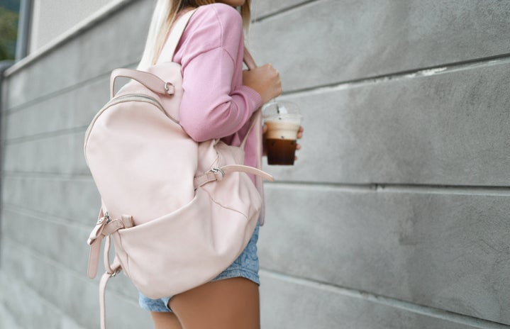 backpack and iced coffee