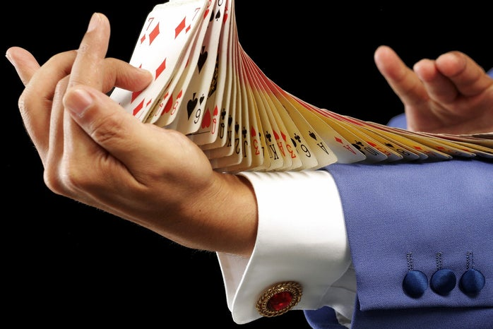 man doing card flourish