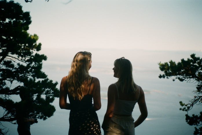 Two women looking at each other smiling