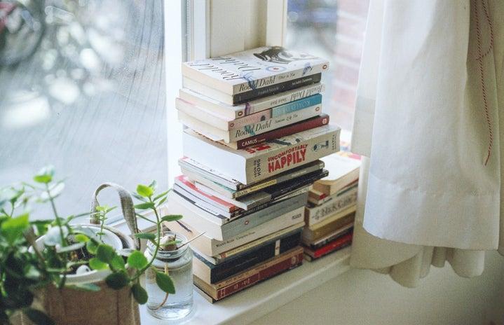 book sitting on a windowsill