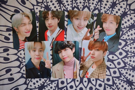 BTS photocards on printed background