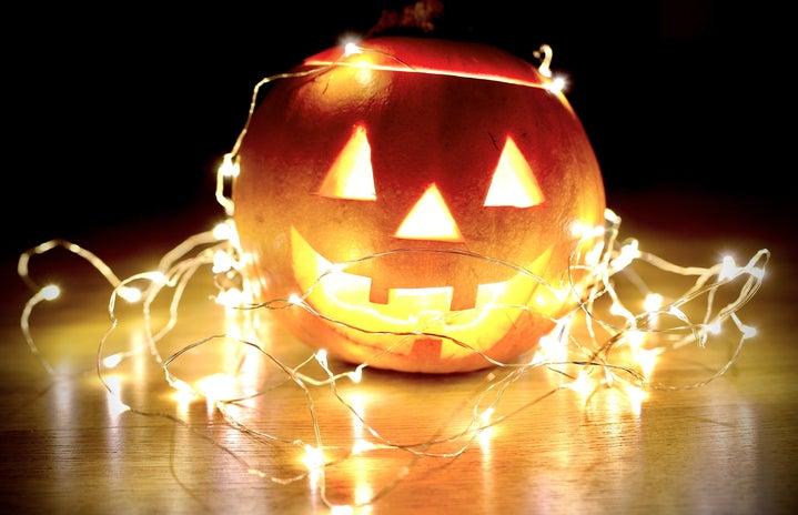 pumpkins with starry lights around it