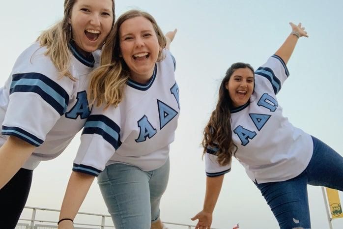 Three friends in sorority jerseys
